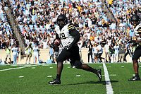 CHAPEL HILL, NC - SEPTEMBER 21: Demetrius Taylor #48 of Appalachian State University returns a fumble recovery for a touchdown during a game between Appalachian State University and University of North Carolina at Kenan Memorial Stadium on September 21, 2019 in Chapel Hill, North Carolina.