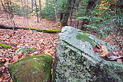 Large stone with blasting hole along the Thornton Gore Road in Thornton, New Hampshire. This was an old hill farm community that was abandoned during the 19th century.