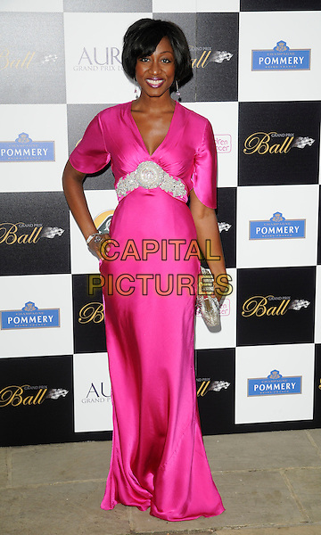 BEVERLEY KNIGHT .Attending The Grand Prix Ball at The Hurlingham Club, London, England, .UK, 7th July 2010. .full length bright pink long maxi dress hand on hip clutch bag silver beaded CAP/CAN.©Can Nguyen/Capital Pictures.