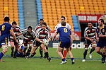 Ben Meyer has the forward pack in support as he makes a run upfield during the Air NZ Cup game between Counties Manukau & Otago played at Mt Smart Stadium,Auckland on the 29th of July 2006. Otago won 23 - 19.