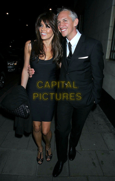 DANIELLE BUX & GARY LINEKER.The Royston Blythe Hair Salon at The Dorchester Launch Party, The Dorchester, London, England..May 18th 2009. .full length black dress couple open toe strap shoes suit.CAP/MEG.©Mega Pictures/Capital Pictures.
