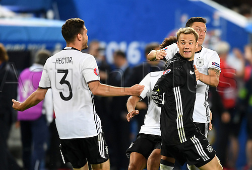 Germany players with Jonas Hector (L-R) and goalkeeper Manuel Neuer and Mesut Oezil celebrate after winning the penalty shoot-out of the UEFA EURO 2016 quarter final soccer match between Germany and Italy at the Stade de Bordeaux in Bordeaux, France, 02 July 2016.