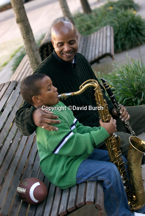 African American man with his grandson playing musical instruments