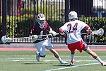 Orange, CA 05/01/10 - Nick Wilks (Chapman # 24) and Marc Napp (LMU # 1) in action during the LMU-Chapman MCLA SLC semi-final game in Wilson Field at Chapman University.  Chapman advanced to the final by defeating LMU 19-10.