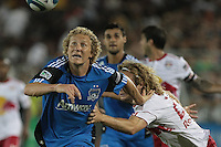 San Jose Earthquakes forward Steven Lenhart (24) chases down the ball ahead of New York Red Bulls defender Stephen Keel (22). The San Jose Earthquakes tied the New York Red Bulls 2-2 at Stanford Stadium in Stanford, California on July 2nd, 2011.
