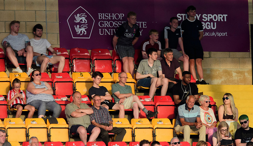 Lincoln City fans watch their team in action<br /> <br /> Photographer Chris Vaughan/CameraSport<br /> <br /> Football Pre-Season Friendly - Lincoln City v Stoke City - Wednesday July 24th 2019 - Sincil Bank - Lincoln<br /> <br /> World Copyright © 2019 CameraSport. All rights reserved. 43 Linden Ave. Countesthorpe. Leicester. England. LE8 5PG - Tel: +44 (0) 116 277 4147 - admin@camerasport.com - www.camerasport.com