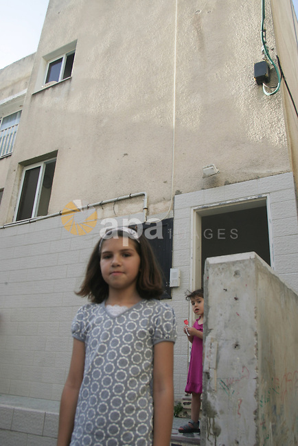 The daughter of Sheikh Raed Salah, the leader of the Islamic Movement in Israel stands in front of her house in the town of Oum Al-Fahem on June 1, 2010. Sheik Raed Salah was on one of the stormed six ships carrying hundreds of pro-Palestinian activists on an aid mission to the blockaded Gaza Strip, killing at least 10 activists and wounded dozens of others after encountering unexpected resistance while boarding the vessels. Photo by Mahfouz Abu Turk