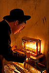 Israel, Jerusalem. Lighting the Hanukkah candles at the Jewish Orthodox Me?a She?arim quarter, 2004<br />