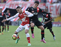 BOGOTÁ -COLOMBIA, 29-09-2013. Yulian Anchico (I) de Santa Fe disputa el balón con German Cano (D) del Medellín durante partido  por la fecha 12 de la Liga Postobon II 2013 disputado en el estadio el Campín de la ciudad de Bogotá./ Santa Fe player Yulian Anchico (L) fights for the ball with Medellin player German Cano (R) during match of the 12th date for the Postobon League II 2013 played at El Campin stadium in Bogotá city. Photo: VizzorImage/Gabriel Aponte/STR