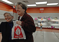 B. Dalton bookstore manager Nancy Kenish, left, gets a hug from the customer who bought the last book at the B. Dalton store at a Westerville, Ohio, suburban strip center. The store, one of the smallest in the chain, was closing after nearly two decades tucked in the corner of a building housing an insurance company and a balloon store.