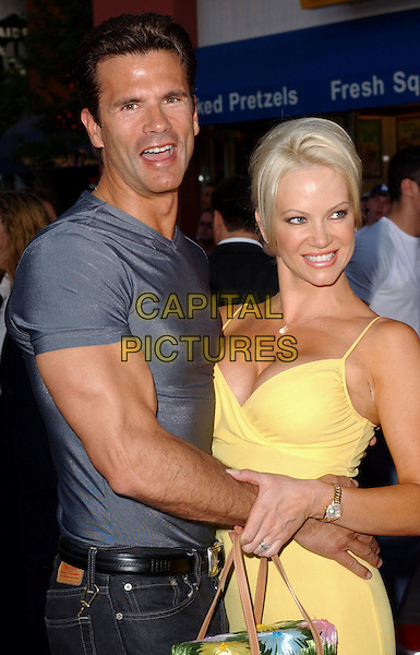 LORENZO LAMAS & BARBARA MOORE.Attending the world premiere of movie Van Helsing at The Universal City Walk in Universal City, California..May 3rd 2004.half length half-length boobs yellow dress plunging neckline cleavage tight t-shirt hugging .*UK sales only*.www.capitalpictures.com.sales@capitalpictures.com.©Capital Pictures