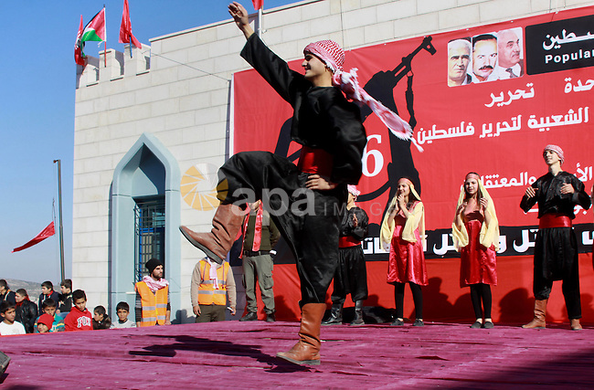 Palestinians take part in a rally in the West Bank city of Jenin on December 21, 2013, marking the 46th anniversary of the founding of the Popular Front for the Liberation of Palestine (PFLP), a Palestinian Marxist revolutionary organization established in 1967. Photo by Nedal Eshtayah