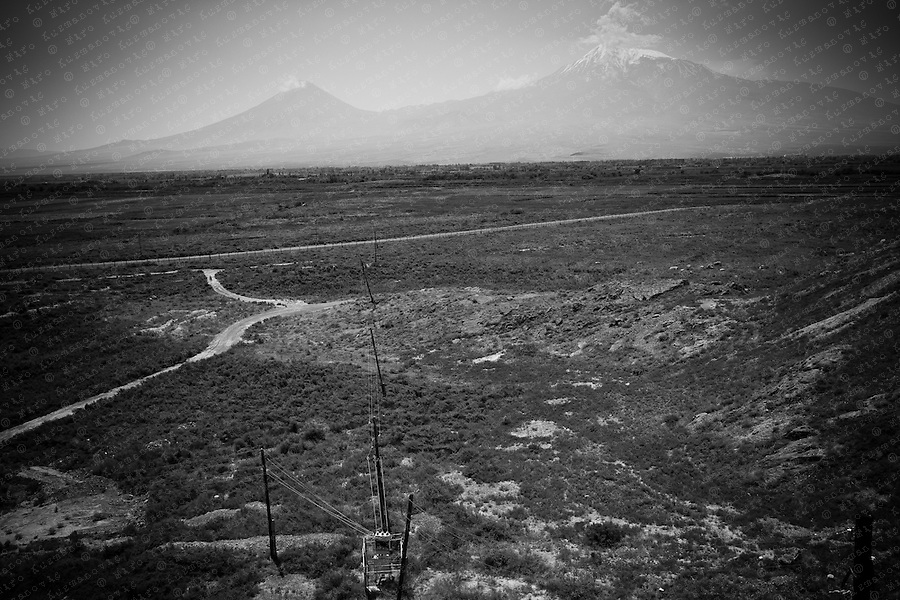 Ararat valley is seen in front of Mount Ararat, the most important symbol of national identity and of their ancient homeland , from the Khor Virap monastery next to the border with Turkey, south of Artashat. The volcanic mountain is located in Eastern Turkey and according to legend, the Noah`s ark rested on Mountain Ararat after the Great Flood described in the Bible. Armenians consider themselves direct descendants of Noah, survivor of the Biblical flood.