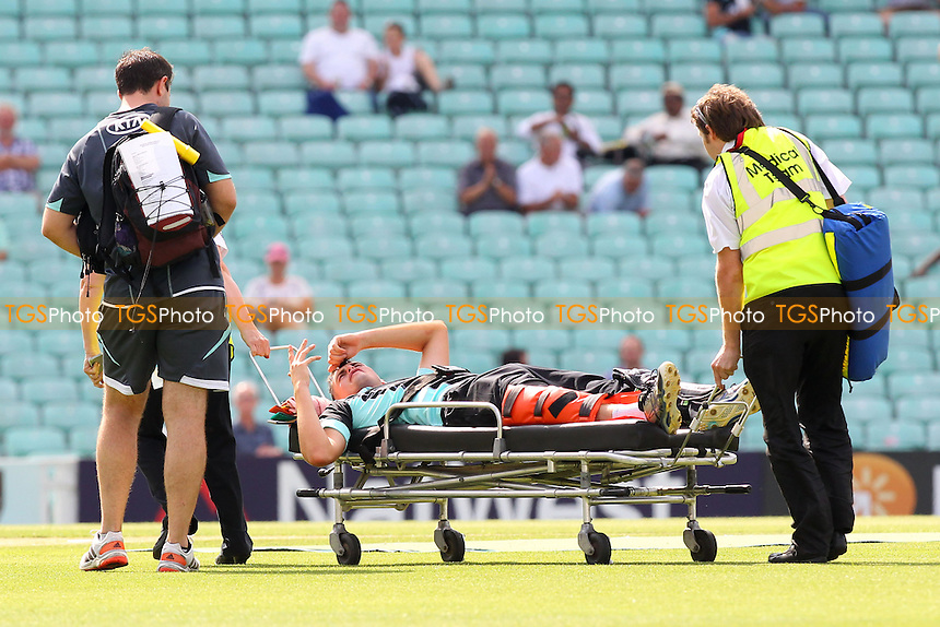 Dominic Sibley of Surrey is stretchered off the field with an injury - Surrey Lions vs Essex Eagles - Yorkshire Bank YB40 Cricket at the Kia Oval, Kennington, London - 02/08/13 - MANDATORY CREDIT: Gavin Ellis/TGSPHOTO - Self billing applies where appropriate - 0845 094 6026 - contact@tgsphoto.co.uk - NO UNPAID USE