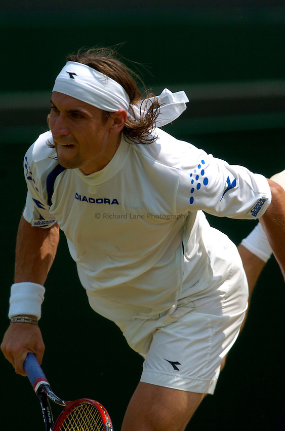 Photo: Richard Lane..Wimbledon Championships. 03/07/2006. .David Ferrer of Spain serves.