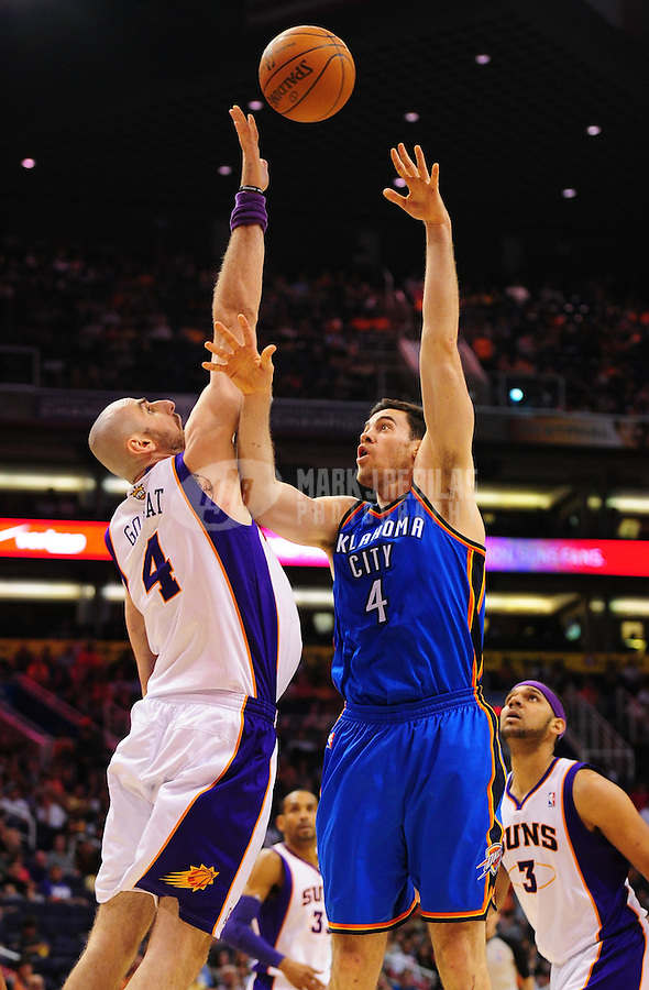 Mar. 30, 2011; Phoenix, AZ, USA; Oklahoma City Thunder forward Nick Collison (right) takes a shot against Phoenix Suns forward Marcin Gortat at the US Airways Center. Mandatory Credit: Mark J. Rebilas-