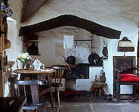 The chimney in the living room was made by hand, fixing vertical laths into the beam over the fireplace, weaving the hazel loosely between them and using plaster mixed with horsehair to hold the framework together