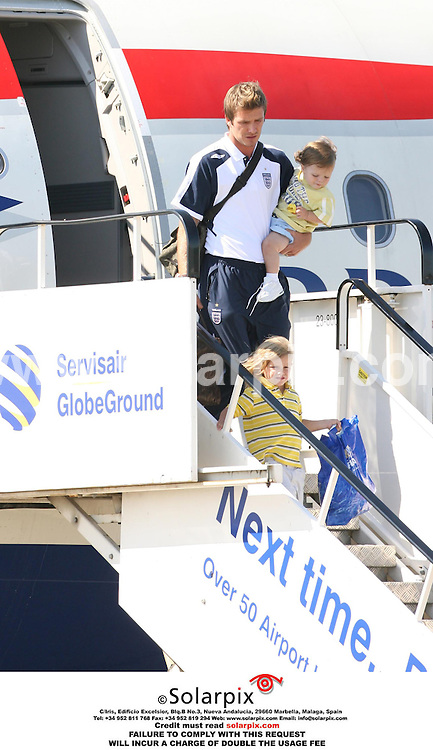 ALL ROUND PICTURES FROM SOLARPIX.COM. .The England Team arrive at Stansted Airport on 02.07.06 after their exit from the 2006 World Cup. Job Ref: 2533/EBR..This pic: David, Romeo and Cruz Beckham..MUST CREDIT SOLARPIX.COM OR DOUBLE FEE WILL BE CHARGED..
