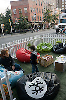 Bean Bag chairs, bike racks and white picket fences at Crumpler Park(ing) on Eighth Avenue and West Fourth Street in the West Village.