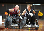 VIctoria's Josh Hose slips past QLd's CHris Bond during the final of the National Wheelchair Rugby Championships 2013.<br />