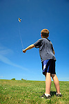 Boy flying kite, Cape Elizabeth, Maine, USA