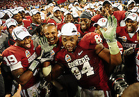 Jan. 1, 2011; Glendale, AZ, USA; Oklahoma Sooners defensive back (19) Demontre Hurst and defensive end (84) Frank Alexander celebrate with teammates following the game against the Connecticut Huskies in the 2011 Fiesta Bowl at University of Phoenix Stadium. The Sooners defeated the Huskies 48-20. Mandatory Credit: Mark J. Rebilas-