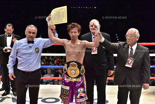 (C-R) Ryoichi Taguchi (JPN), Shinji Kushiro,<br /> MAY 6, 2015 - Boxing :<br /> Ryoichi Taguchi of Japan has his arms raised by referee Ferlin Marsh and JBC commissioner Shinji Kushiro as he celebrates with his champion belt after winning the WBA light flyweight title bout at Ota-City General Gymnasium in Tokyo, Japan. (Photo by Hiroaki Yamaguchi/AFLO)