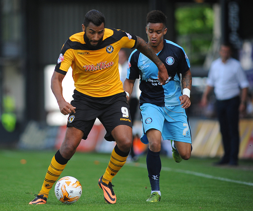 Newport County's Rene Howe under pressure from Wycombe Wanderers' Paris Cowan-Hall<br /> <br /> Photographer Kevin Barnes/CameraSport<br /> <br /> Football - The Football League Sky Bet League Two - Newport County AFC v Wycombe Wanderers - Saturday 9th August 2014 - Rodney Parade - Newport<br /> <br /> &copy; CameraSport - 43 Linden Ave. Countesthorpe. Leicester. England. LE8 5PG - Tel: +44 (0) 116 277 4147 - admin@camerasport.com - www.camerasport.com