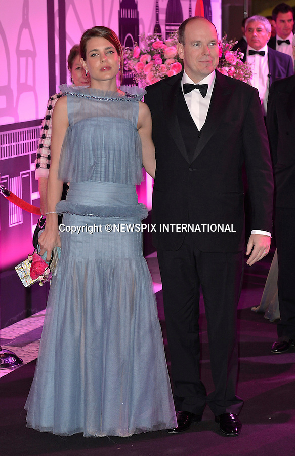 """CHARLOTTE CASIRAGHI AND UNCLE PRINCE ALBERT OF MONACO.attend one of the Principality's premiere event the  """"Monaco Rose Ball..The theme for this year's Ball that raise funds for the Princess Grace Foundation was """"Swinging London""""_Monte Carlo, 24/03/2012.Mandatory Credit Photos: SBM/Newspix International..**ALL FEES PAYABLE TO: """"NEWSPIX INTERNATIONAL""""**..PHOTO CREDIT MANDATORY!!: NEWSPIX INTERNATIONAL(Failure to credit will incur a surcharge of 100% of reproduction fees)..IMMEDIATE CONFIRMATION OF USAGE REQUIRED:.Newspix International, 31 Chinnery Hill, Bishop's Stortford, ENGLAND CM23 3PS.Tel:+441279 324672  ; Fax: +441279656877.Mobile:  0777568 1153.e-mail: info@newspixinternational.co.uk"""