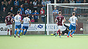 Stenny's Martin Grehan (9) scores their first goal.
