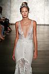 Model walks runway in a V neck mermaid of crochet & Chantilly lace, from Inbal Dror Fall 2018 bridal collection on October 5, 2017; during New York Bridal Fashion Week.