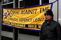 English Defence League (EDL) demonstration<br /> called in protest to the proposed building of a new mosque in Dudley.<br /> <br /> A supporter of the anti - EDL demonstration called by Unite Against Fascism and Love Music Hate Fascism