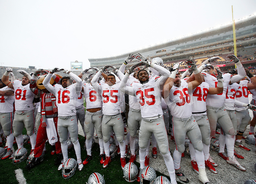 The Ohio State Buckeyes sing Carmen Ohio after the college football game between the Ohio State Buckeyes and the Minnesota Golden Gophers at TCF Bank Stadium in Minneapolis, Saturday morning, November 15, 2014. The Ohio State Buckeyes defeated the Minnesota Golden Gophers 31 - 24. (The Columbus Dispatch / Eamon Queeney)