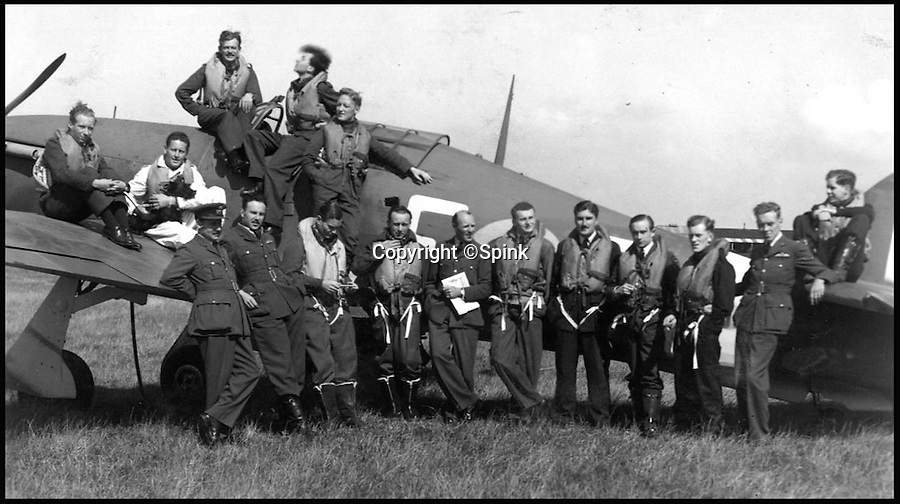 BNPS.co.uk (01202 558833)<br /> Pic: Spink/BNPS<br /> <br /> ***Please Use Full Byline***<br /> <br /> No. 242 Squadron, Manston, August 1941. Hamlyn is seated to the left of the cockpit, one hand in his pocket.<br /> <br /> The remarkable story of a prolific RAF hero who achieved 'ace' status in just two-and-a-half hours of flying has come to light after his medals were put up for sale.<br /> <br /> Squadron Leader Ronald Fairfax Hamlyn went up in his Spitfire three times on August 24, 1940, at the very height of the Battle of Britain.<br /> <br /> He was awarded the Distinguished Flying Medal which, along with the rest of his medals, is being sold in London for an estimated £60,000.