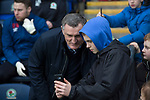 Blackburn Rovers 3 Shrewsbury Town 1, 14/01/2018. Ewood Park, League One. Home manager Tony Mowbray poses for a selfie with a fan by the technical area before Blackburn Rovers played Shrewsbury Town in a Sky Bet League One fixture at Ewood Park. Both team were in the top three in the division at the start of the game. Blackburn won the match by 3 goals to 1, watched by a crowd of 13,579. Photo by Colin McPherson.
