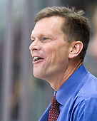 Tim Army (Providence - Head Coach) shares a laugh with one of the officials during warmups. - The Boston University Terriers defeated the visiting Providence College Friars 2-1 on Saturday, October 23, 2010, at Agganis Arena in Boston, Massachusetts.