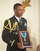 A United States Army honor guard holds the Medal of Honor as the citation is read during the ceremony where US President Donald J. Trump posthumously awarded the Medal of Honor to then-First Lieutenant Garlin M. Conner, U.S. Army, for conspicuous gallantry during World War II in the East Room of the White House in Washington, DC on Tuesday, June 26, 2018.  Conner is being honored for his actions on January 24,1945, while serving as an intelligence officer with Headquarters and Headquarters Company, 3d Battalion, 7th Infantry Regiment, 3d Infantry Division.<br /> Credit: Ron Sachs / CNP