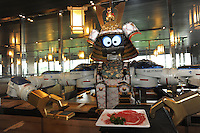 Samurai robot waiter serving food in the Hajime Restaurant, out-skirts of Bangkok, Thailand. Hajime is a Japanese restaurant in Thailand, has samurai style robot serving food to the diners and even do a dance session to entertain guests. This robot are made in Japan and costed about 86,600,000 yen (1,063,717USD). Customers order food from touch panel and Samurai robot will bring ordered food to their table.<br /> 15 Oct 2010