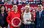 Dayana Yastremska of Ukraine (R2) and Wang Qiang of China (L2) pose for photo with trophy after the singles final match at the WTA Prudential Hong Kong Tennis Open 2018 at the Victoria Park Tennis Stadium on 14 October 2018 in Hong Kong, Hong Kong.