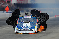 Feb. 12, 2012; Pomona, CA, USA; NHRA funny car driver Tim Wilkerson has a fire under the body of his funny car during the Winternationals at Auto Club Raceway at Pomona. Mandatory Credit: Mark J. Rebilas-