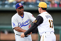 Chattanooga Lookouts manager Razor Shines (44) shakes hands with manager Andy Barkett (17) during introductions before game three of the Southern League Championship Series against the Jacksonville Suns on September 12, 2014 at Bragan Field in Jacksonville, Florida.  Jacksonville defeated Chattanooga 6-1 to sweep three games to none.  (Mike Janes/Four Seam Images)