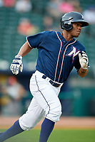 Northwest Arkansas Naturals left fielder Elier Hernandez (21) runs to first base during a game against the Midland RockHounds on May 27, 2017 at Arvest Ballpark in Springdale, Arkansas.  NW Arkansas defeated Midland 3-2.  (Mike Janes/Four Seam Images)