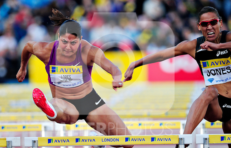 Canada's Priscilla Lopes-Schliep competes during the women's 400m hurdels heats race during the Samsung Diamond League meeting at Crystal Palace in London August 13, 2010.
