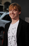 "HOLLYWOOD, CA - JULY 28: Rupert Grint arrives at the ""Rise Of The Planet Of The Apes"" Los Angeles Premiere at Grauman's Chinese on July 28, 2011 in Hollywood, California."