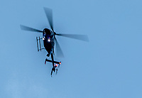 DEL MAR, CA - SEPTEMBER 02: A police helicopter circles as police cordon off the area and secure the crime scene after shots were fired and at least one person was shot before an Ice Cube concert at Del Mar Race Track on September 2, 2018 in Del Mar, California (Photo by Casey Phillips/Eclipse Sportswire/Getty Images)