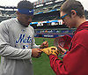 Luca Mazzilli, soon-to-be eighth grader and baseball player from Amityville, gets his glove signed by Dominic Smith of the New York Mets during a visit to Citi Field in Flushing, NY on Saturday, June 23, 2018.