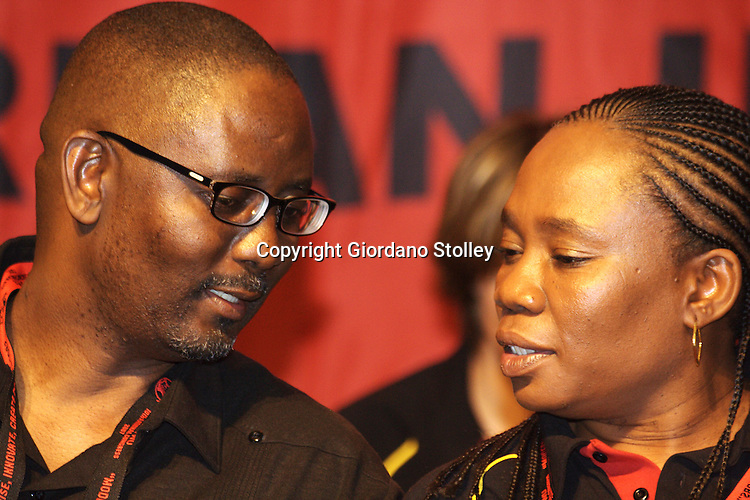 DURBAN - 11 August 2007 - Secretary of the Congress of South African Trade Unions Zwelinzima Vavi (left) and Violet Seboni the 2nd deputy president of Cosatu talke moments before he spoke to delegates on the third day of the 10th congress of the South African Clothing and Textile Workers Union, held in the International Convention Centre in Durban..Picture: Giordano Stolley/Allied Picture Press