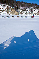 Middie Johnson runs on the Bering Sea ice after leaving the Elim checkpoint during the 2010 Iditarod Sled Dog Race