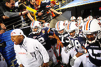 Jan 10, 2011; Glendale, AZ, USA; Auburn Tigers quarterback Cameron Newton (2) leads his team out to the field before the 2011 BCS National Championship game against the Oregon Ducks at University of Phoenix Stadium.  Mandatory Credit: Mark J. Rebilas-
