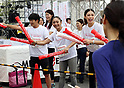 September 30, 2017, Tokyo, Japan - Miss Universe 2007 Riyo Mori (R), former figure skater Miki Ando (C) and Takahiko Kozuka (L) cheer for runners at a charity run for the Special Olympics at Toyota's showroom Mega Web in Tokyo on Saturday, September 30, 2017. Some 1,800 people participated the charity event as Japan's Special Olympic Games will be held in Aichi in 2018.   (Photo by Yoshio Tsunoda/AFLO) LWX -ytd-